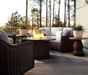 Stylish patio furniture and accessories in a summer backyard