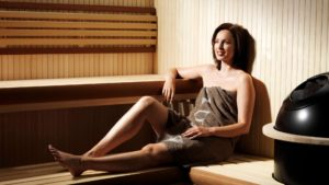 a woman enjoying all of the awesome health benefits of saunas